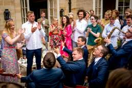 The London Essentials band playing at a wedding garden party