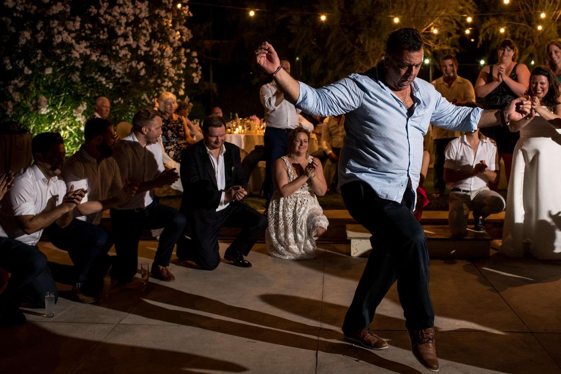 An Athens Wedding photographer capturing greek dancing