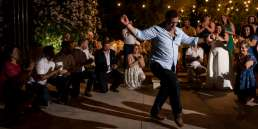 An Athens Wedding photographer capturing greek dancing