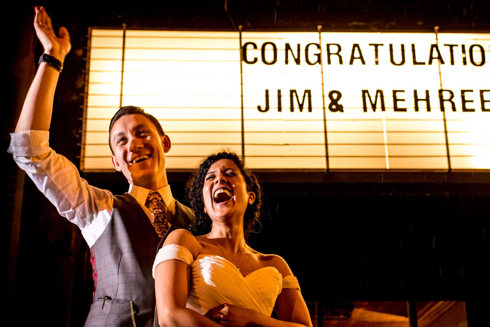Jim and Mehreen outside MC Motors Dalston for their night portrait