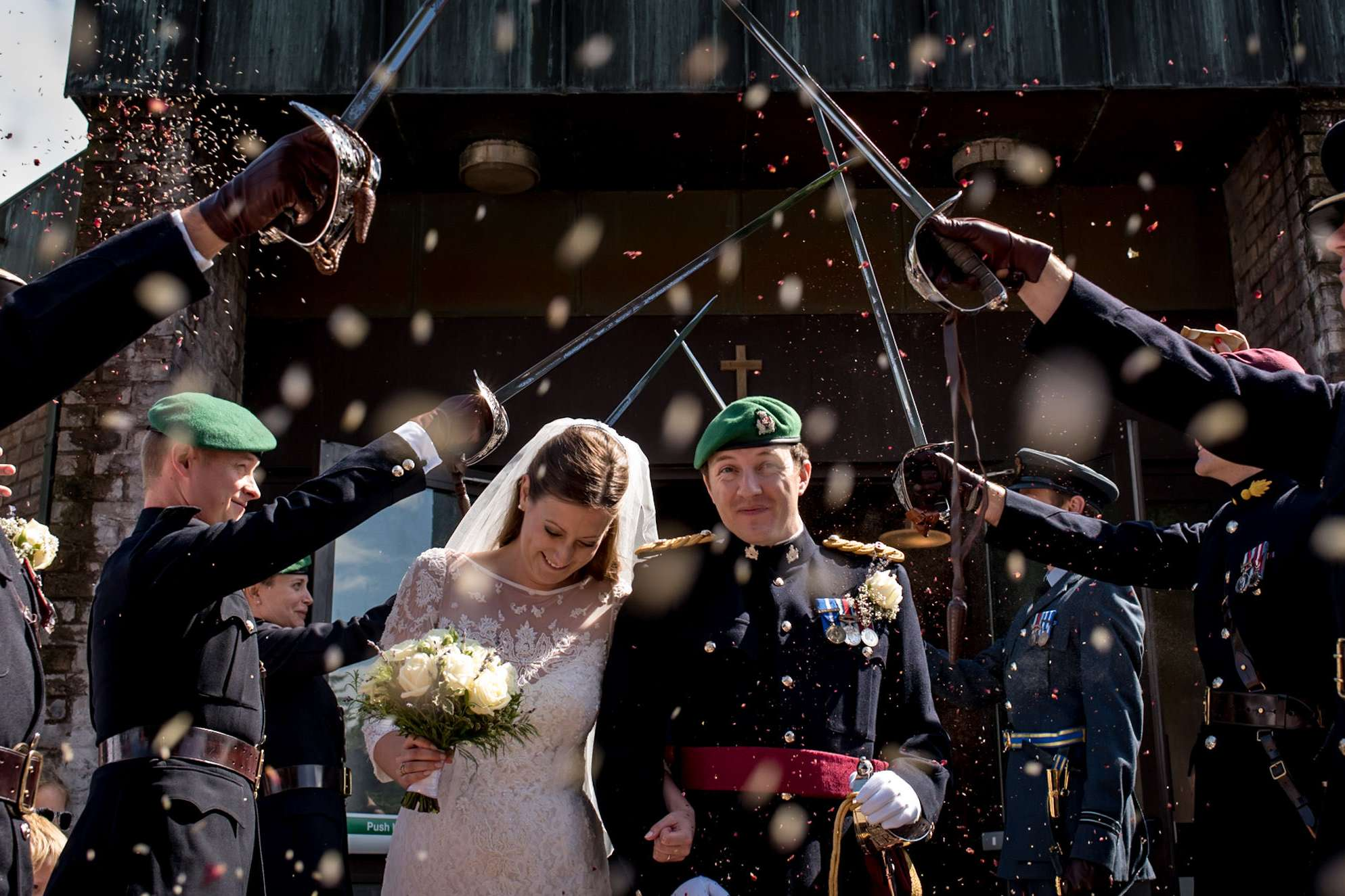 honour guard and confetti at this fun military wedding