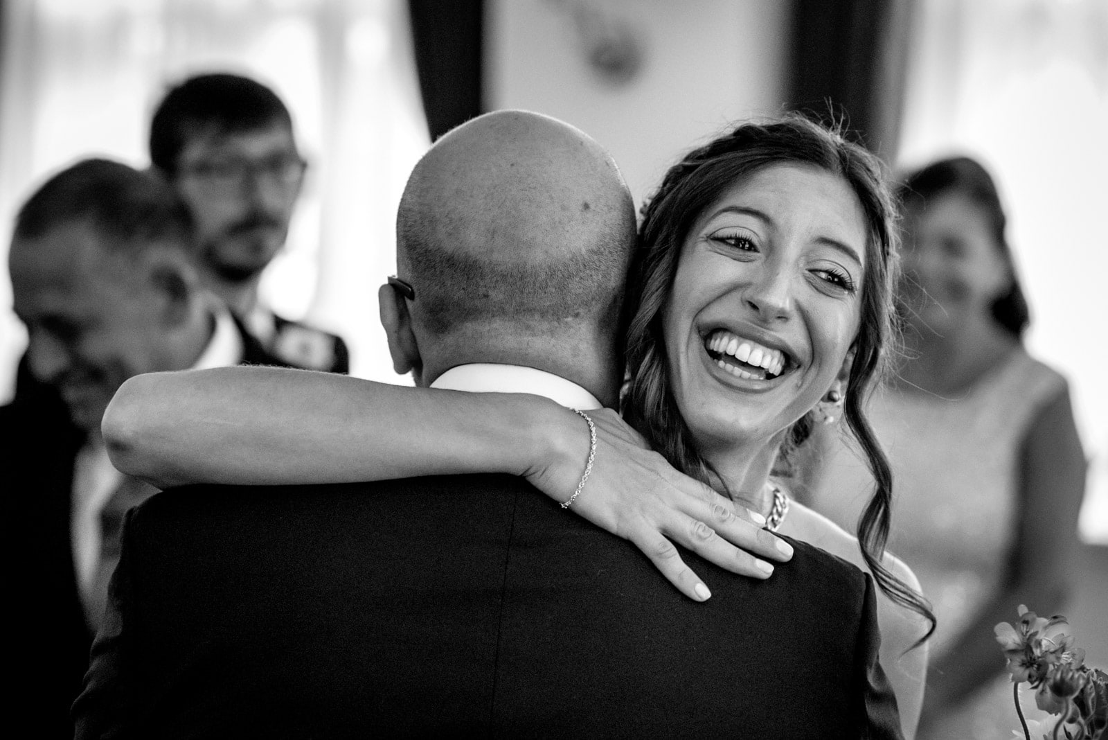 bride crying and hugging groom at their intimate london wedding at Ealing town hall