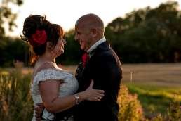 Night circus themed wedding bride and groom sunset portrait