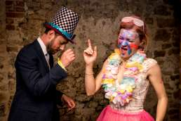 Bride and groom partying in UV paint at their Unicorn Theatre wedding in Abingdon