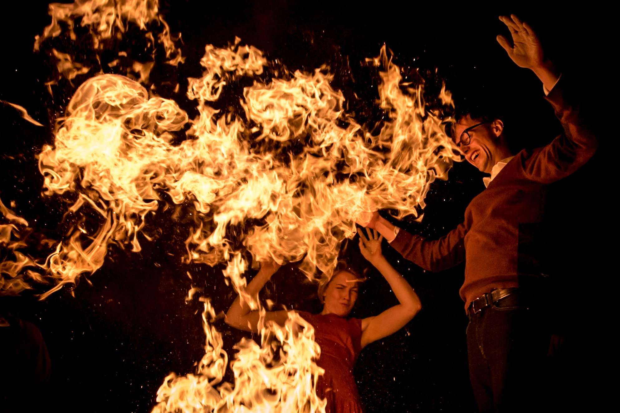 wedding couple in tuscany dancing around a fire in Italy
