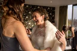 bride laughing in her wedding dress