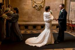 bride and groom seeing each other for the first time at St John's chapel in Cambridge for their winter wedding