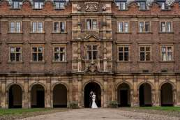 winter wedding bride and groom portraits in St John's College Cambridge