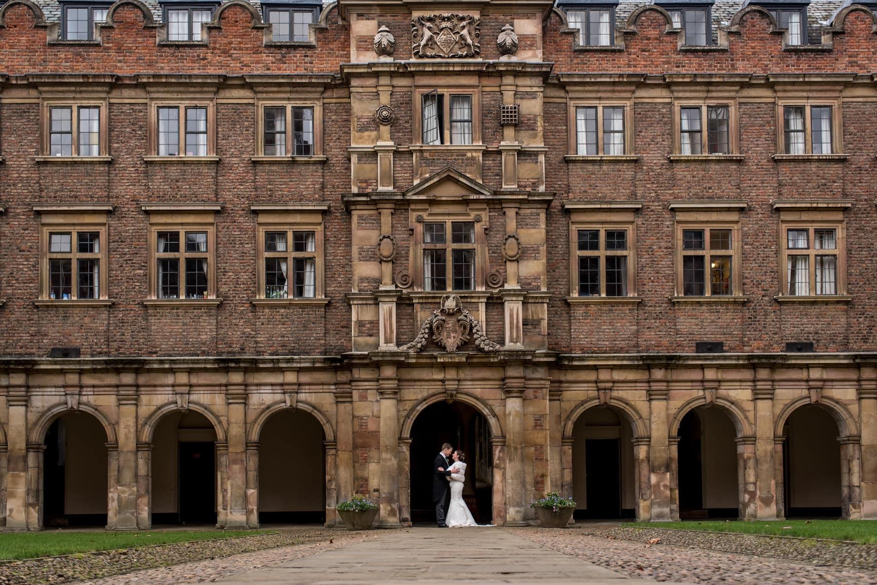 winter wedding bride and groom portraits in St John's College Cambridge