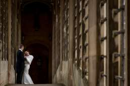 bride and groom laughing at their Cambridge Wedding on the Bridge of Sighs