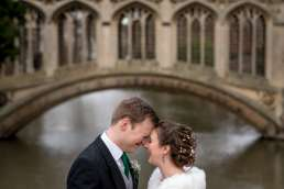 bridge and groom wedding portraits in front of the Bridge of Sighs in Cambridge