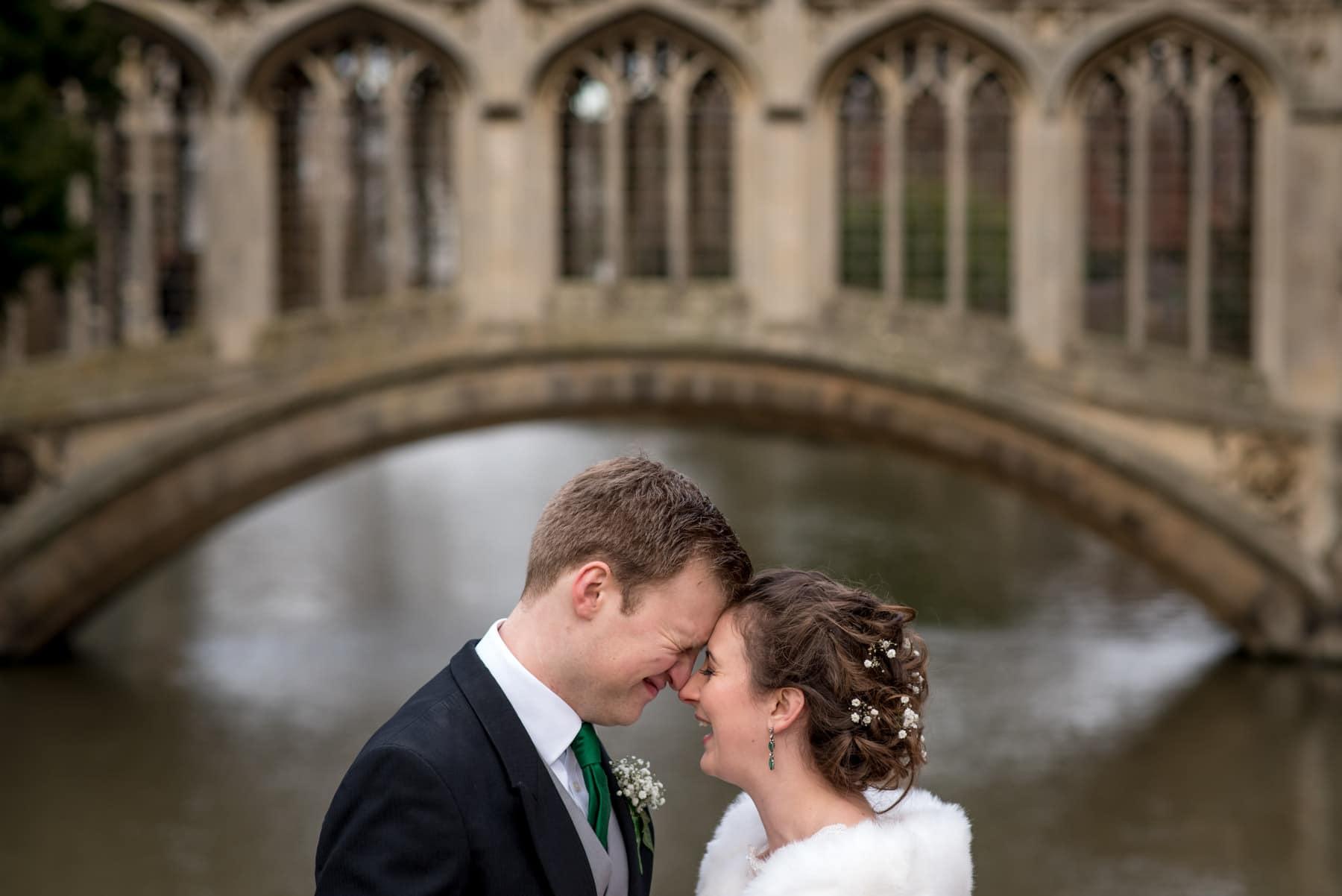 bridge and groom wedding portraits in front of the Bridge of Sighs in Cambridge