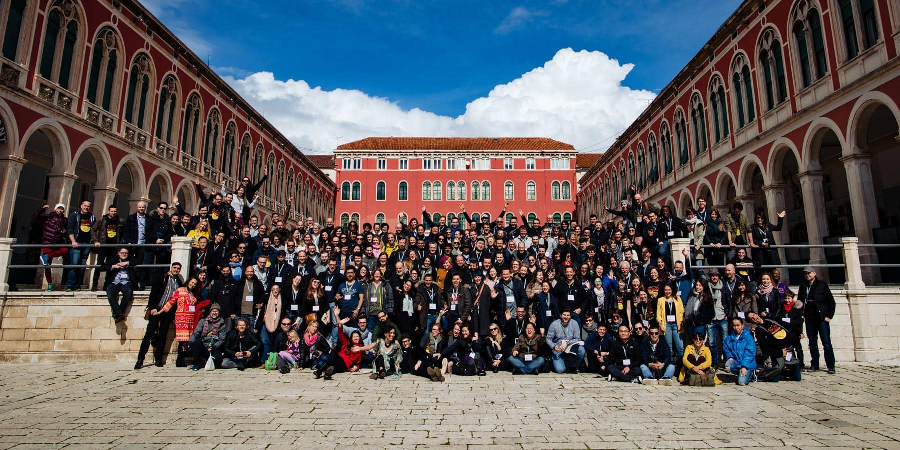 A group of attendees standing on the steps for the fearless wedding photography conference in Europe