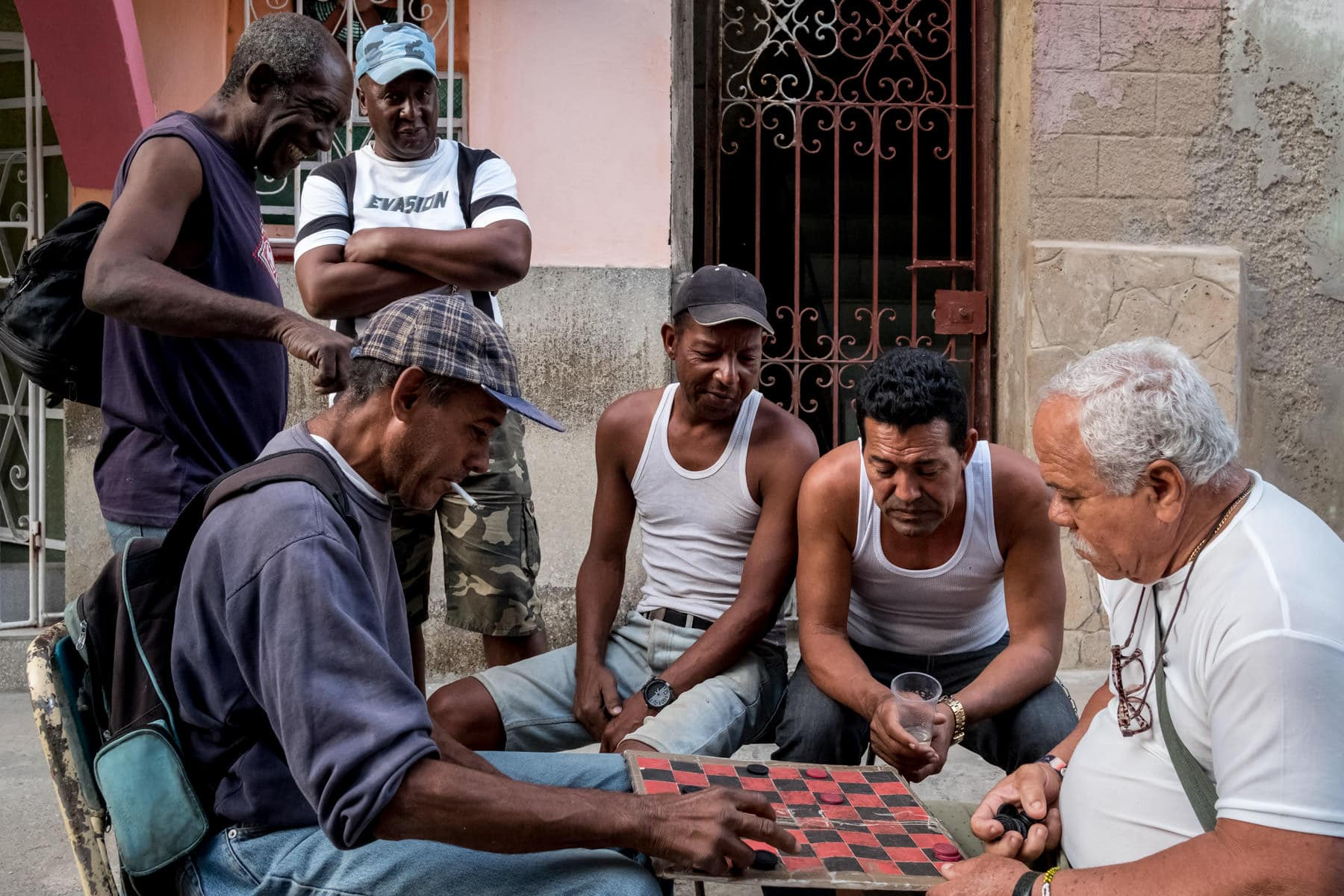 Cuban men playing checkers on the street in Havana