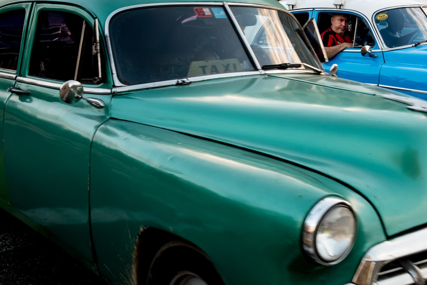 Classic green and blue Cuban cars in havana