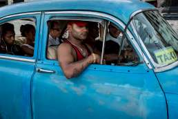 Cubans in a blue taxi
