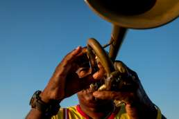 A trumpet player in the sun at sunset in Havana