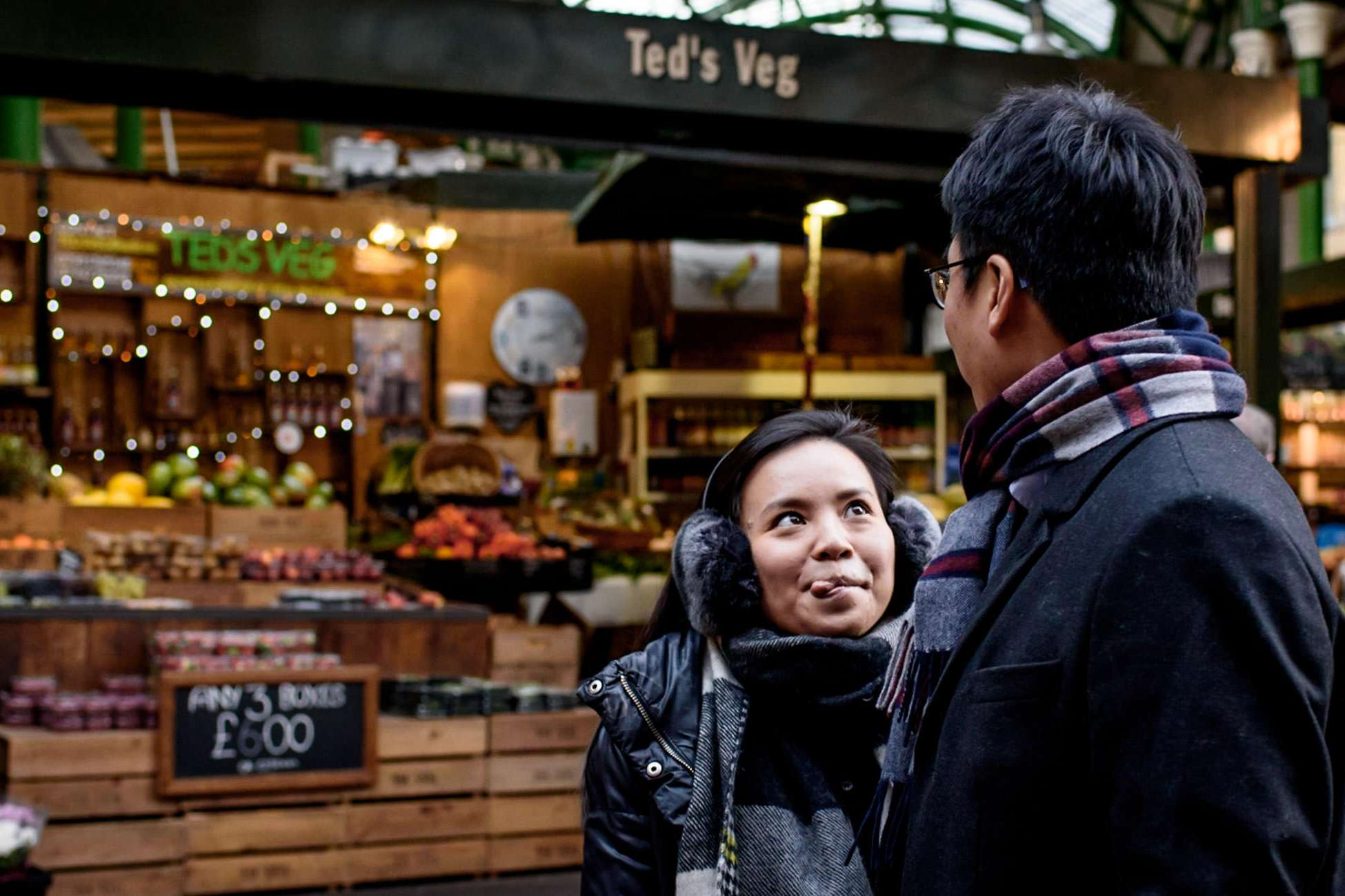 girl sticking her tongue out at borough market during her engagement shoot in London