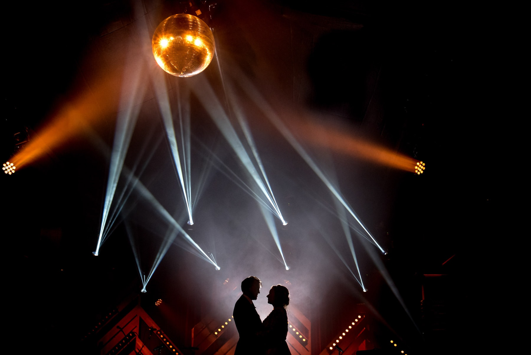 A photo of a couple's first dance with a disco ball, taken by wedding photographer Matt Badenoch