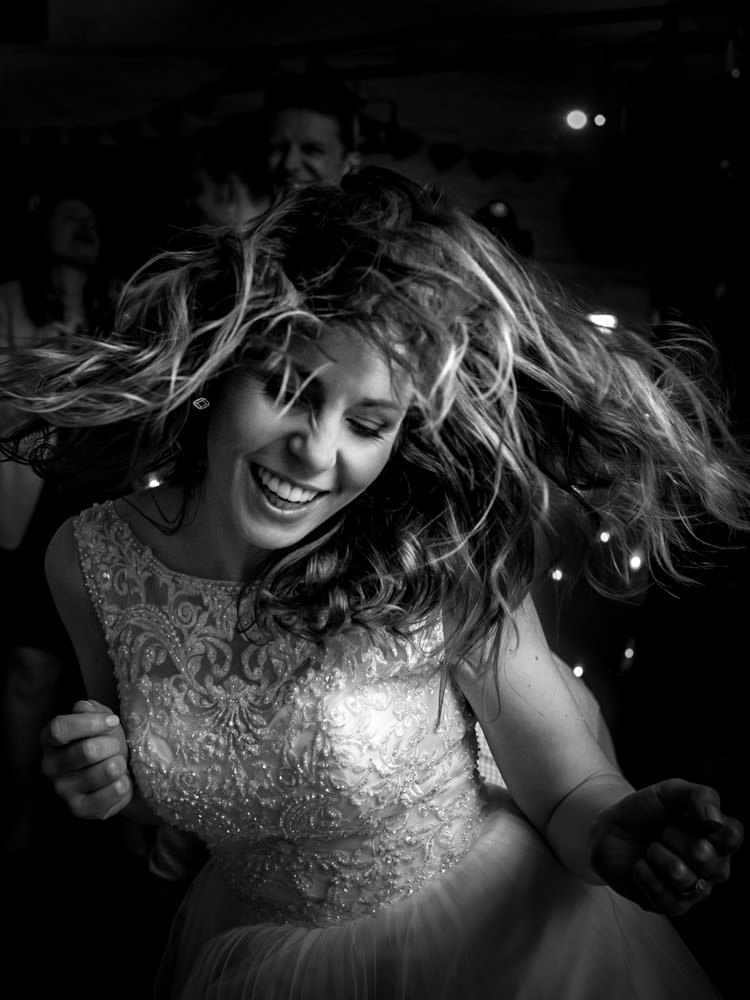 Photo of a bride dancing at her London wedding