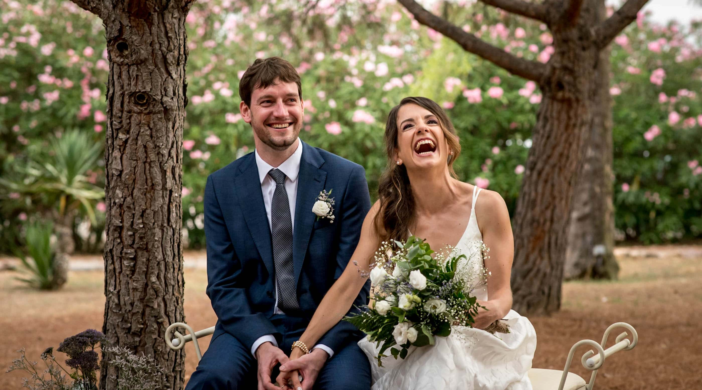 couple laughing during their outdoor wedding ceremony
