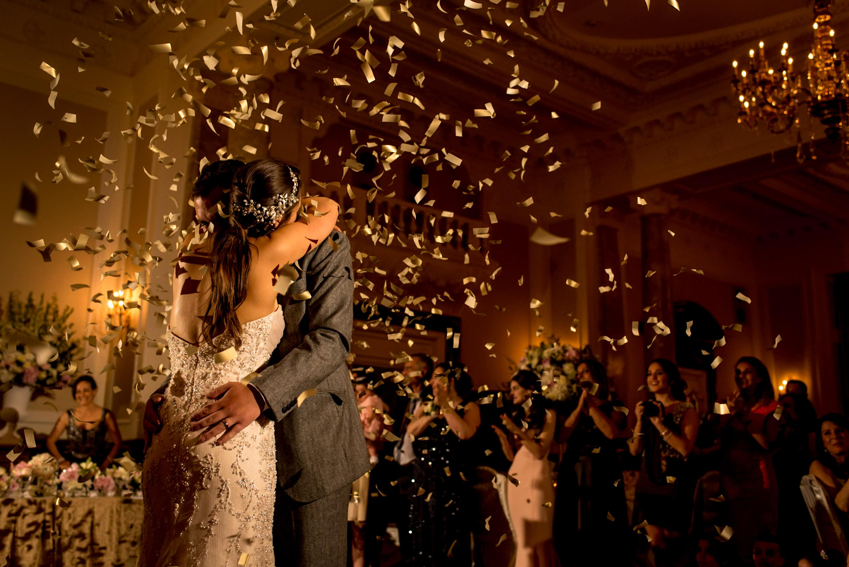 gold confetti cannons firing during the first dance