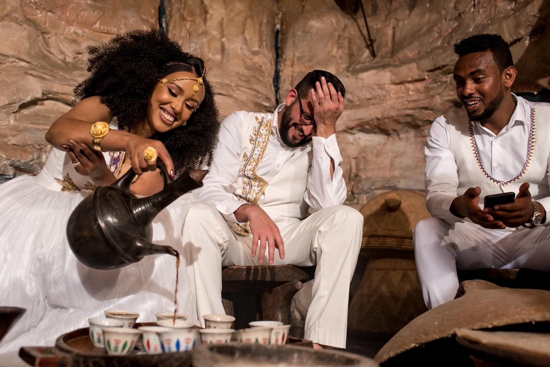 couple during coffee ceremony during their Ethiopian/ US fusion wedding