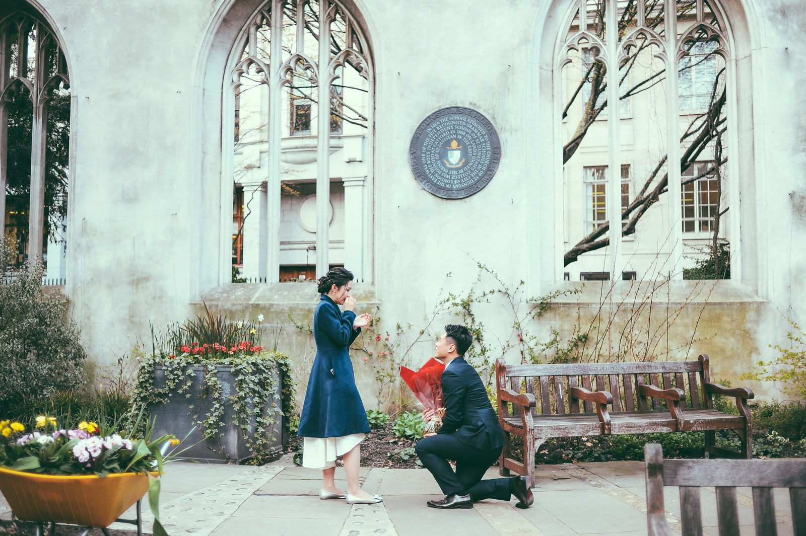 Photo of a man proposing to his girlfriend at a church for their london proposal