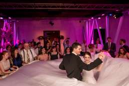 photo of jewish bride and groom dancing with the white sheet at their wedding