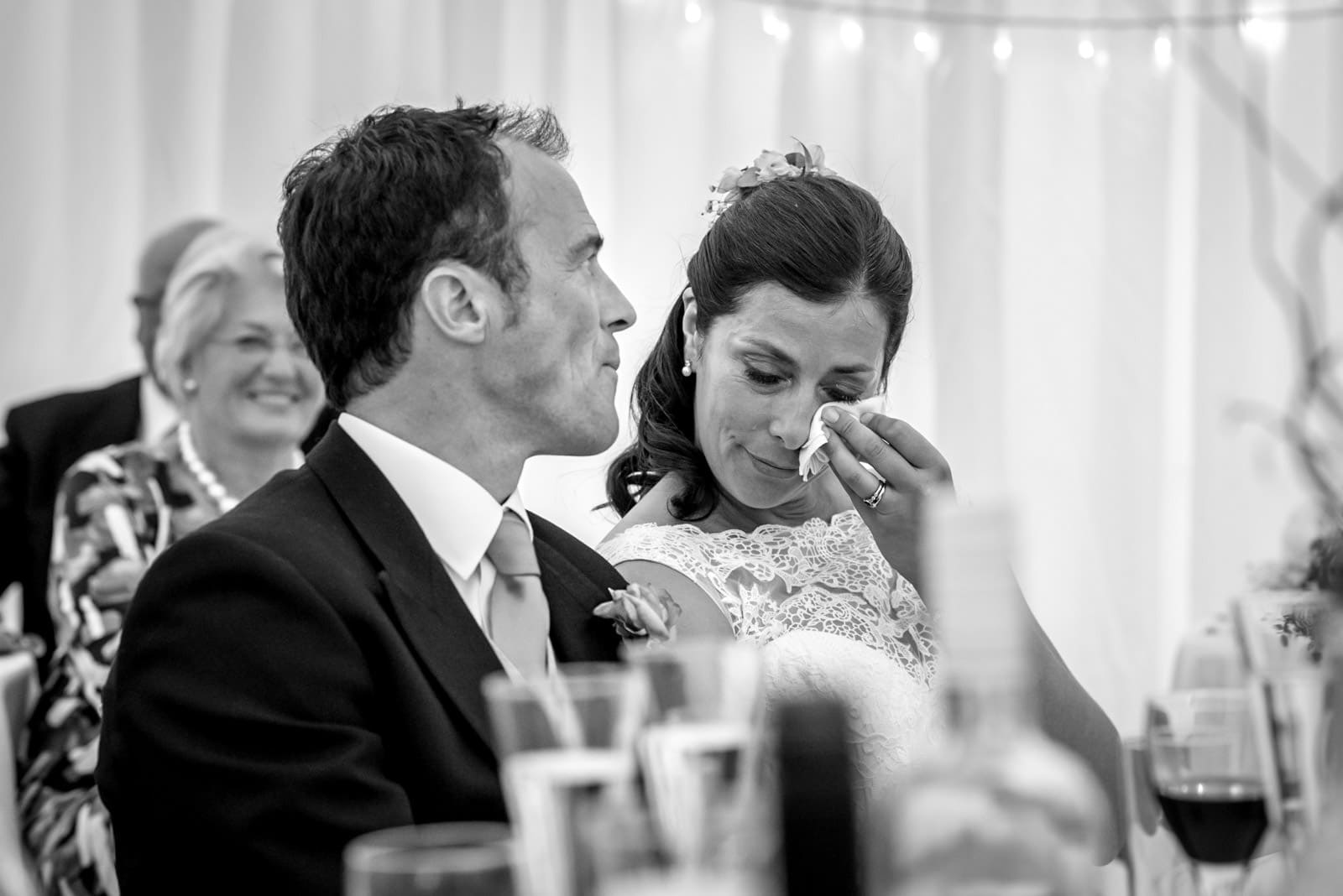 black and white photo of the bride crying during the wedding speeches