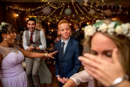 photo of guests laugh on the dance floor at this wedding