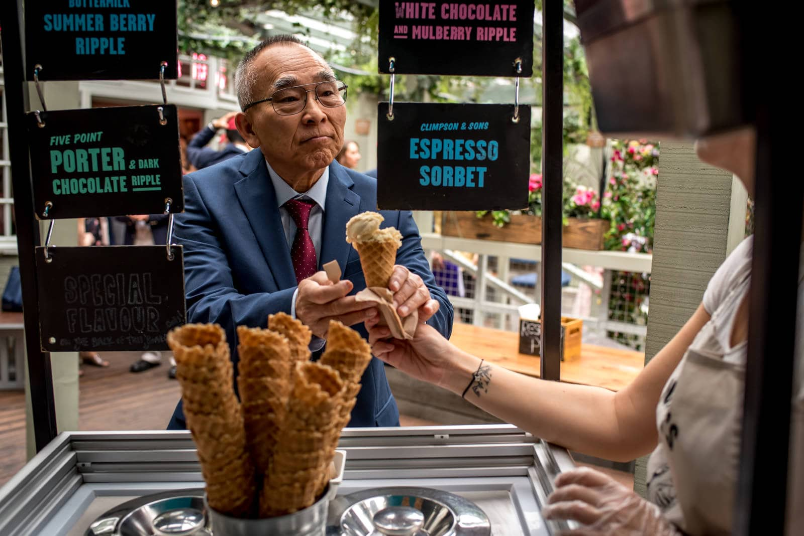 photo of groom's dad getting icecream during the wedding reception