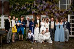 formal photo of the bride and groom and their families
