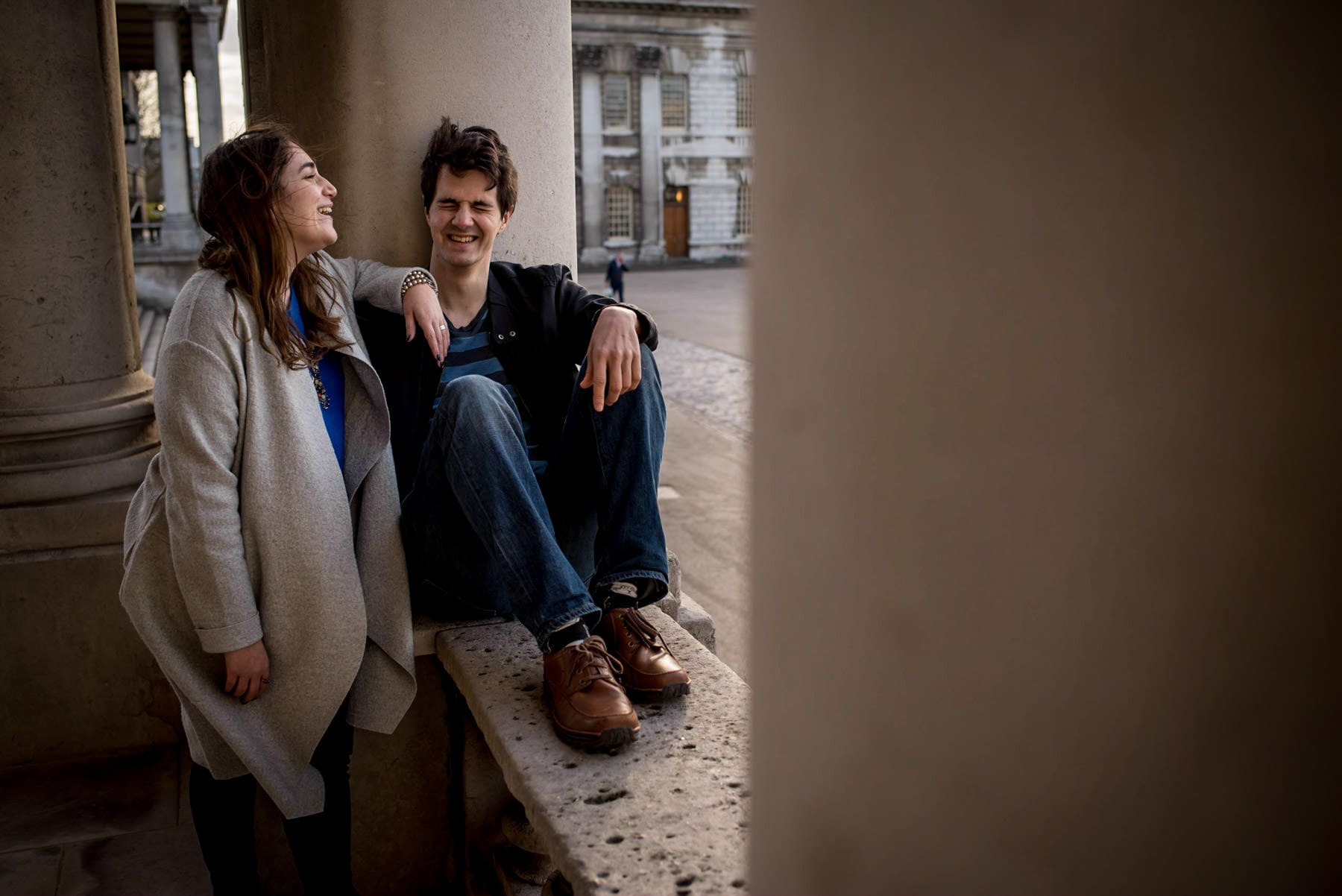 Couple laughing during their proposal photo shoot in London