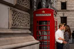 Photo of a couple kissing against a red phone box during their London photography shoot