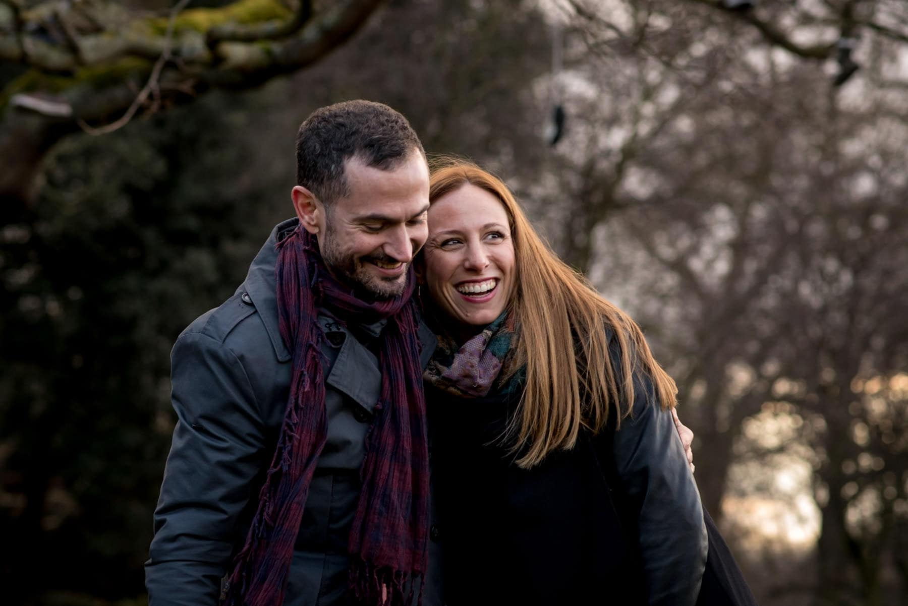 Photo of a couple laughing during their proposal shoot in Regents Park