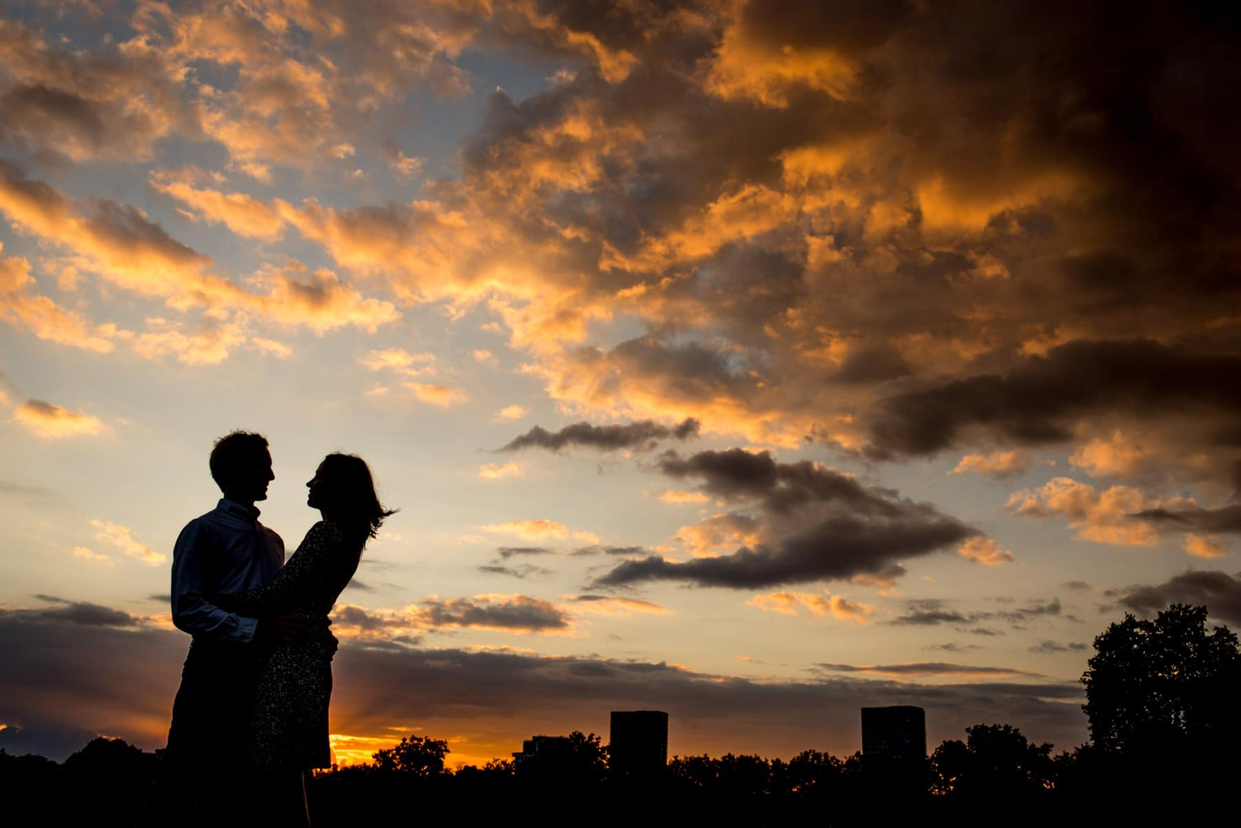 Photo of a silhouette of a couple in London at sunset