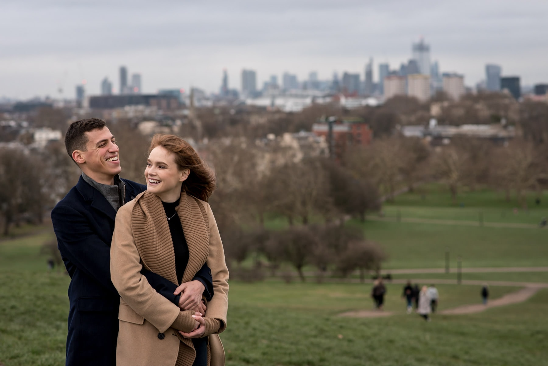 A couple on their London proposal photography shoot at the top of Primrose Hill