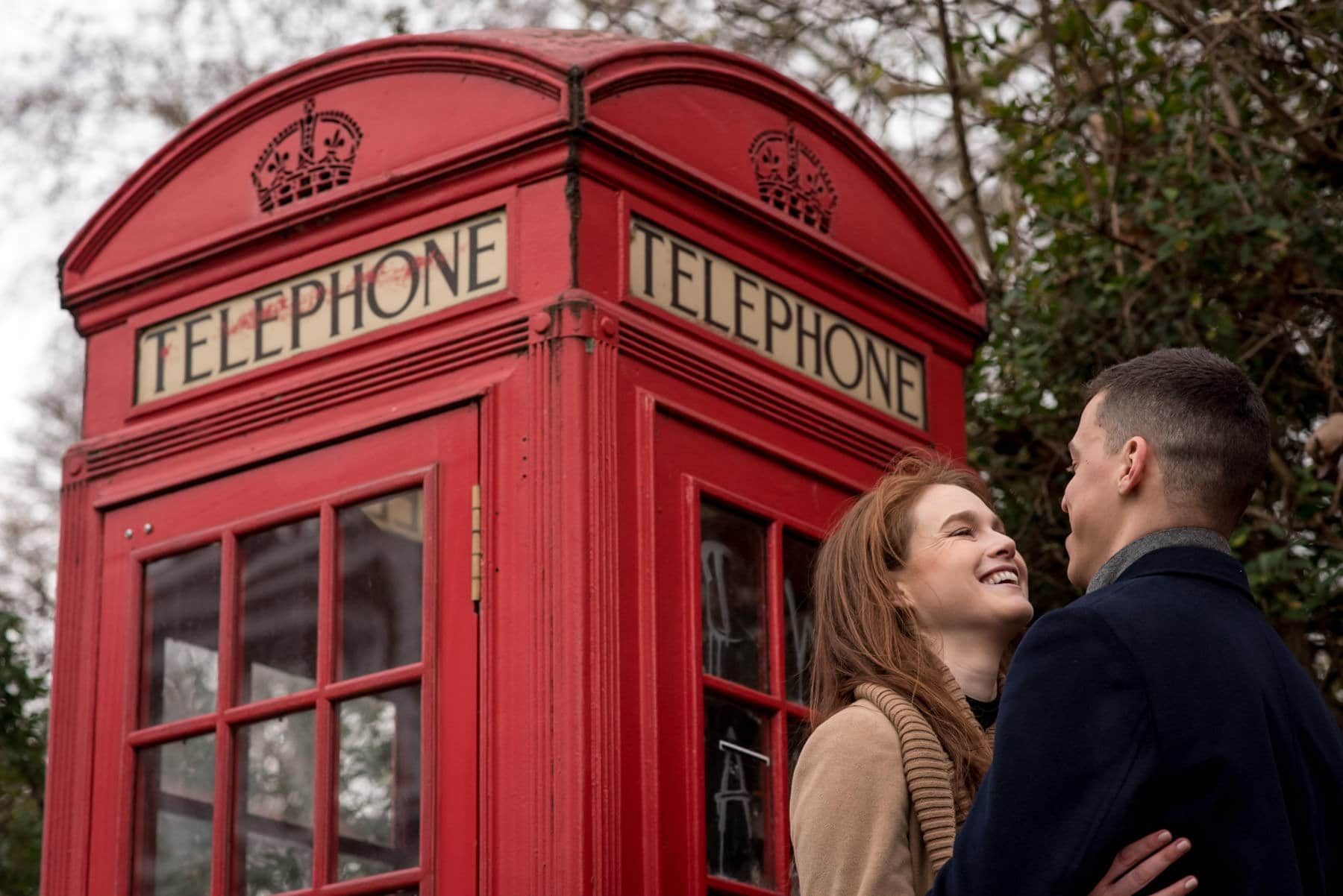 Couple on their engagement shoot in front of a Red London Telephone box
