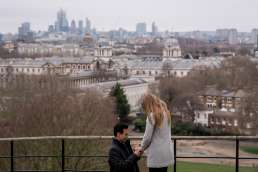 A man proposing to his girlfriend in Greenwich park with views over London