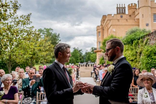 Grooms during their ceremony taken by london wedding photographer Matt Badenoch
