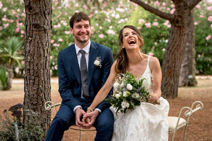 Couple laughing during their wedding ceremony