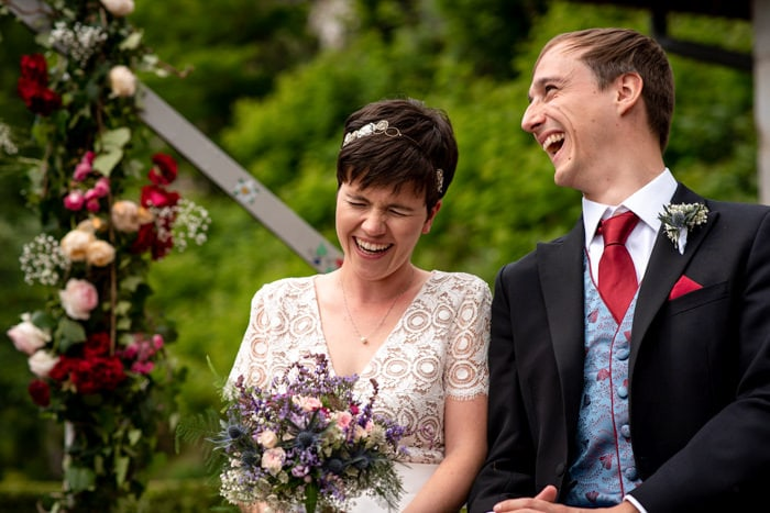 Couple laughing during their countryside wedding ceremony