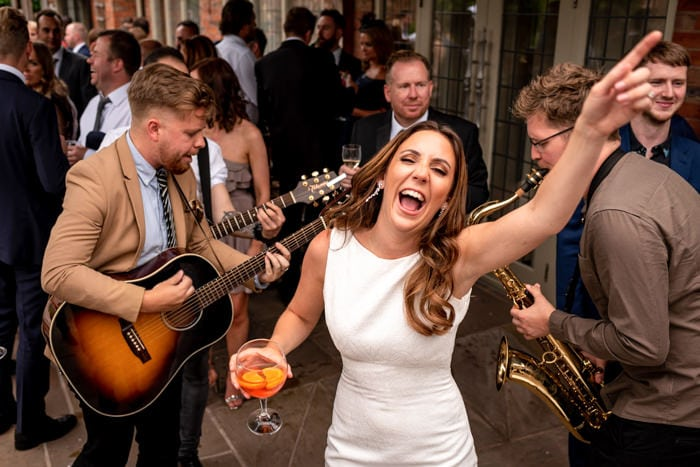 bride dancing with a band at her london wedding