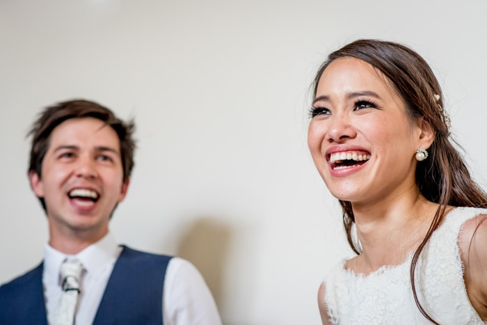 Photo of chinese couple laughing taken by london wedding photographer Matt Badenoch