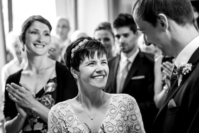 black and white photo of bride smiling at her groom during a london wedding
