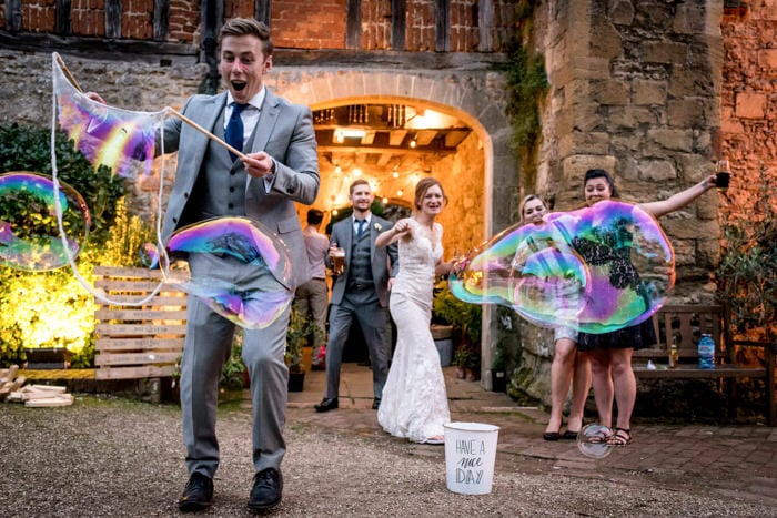 Photo of wedding guests in London playing with giant balloons