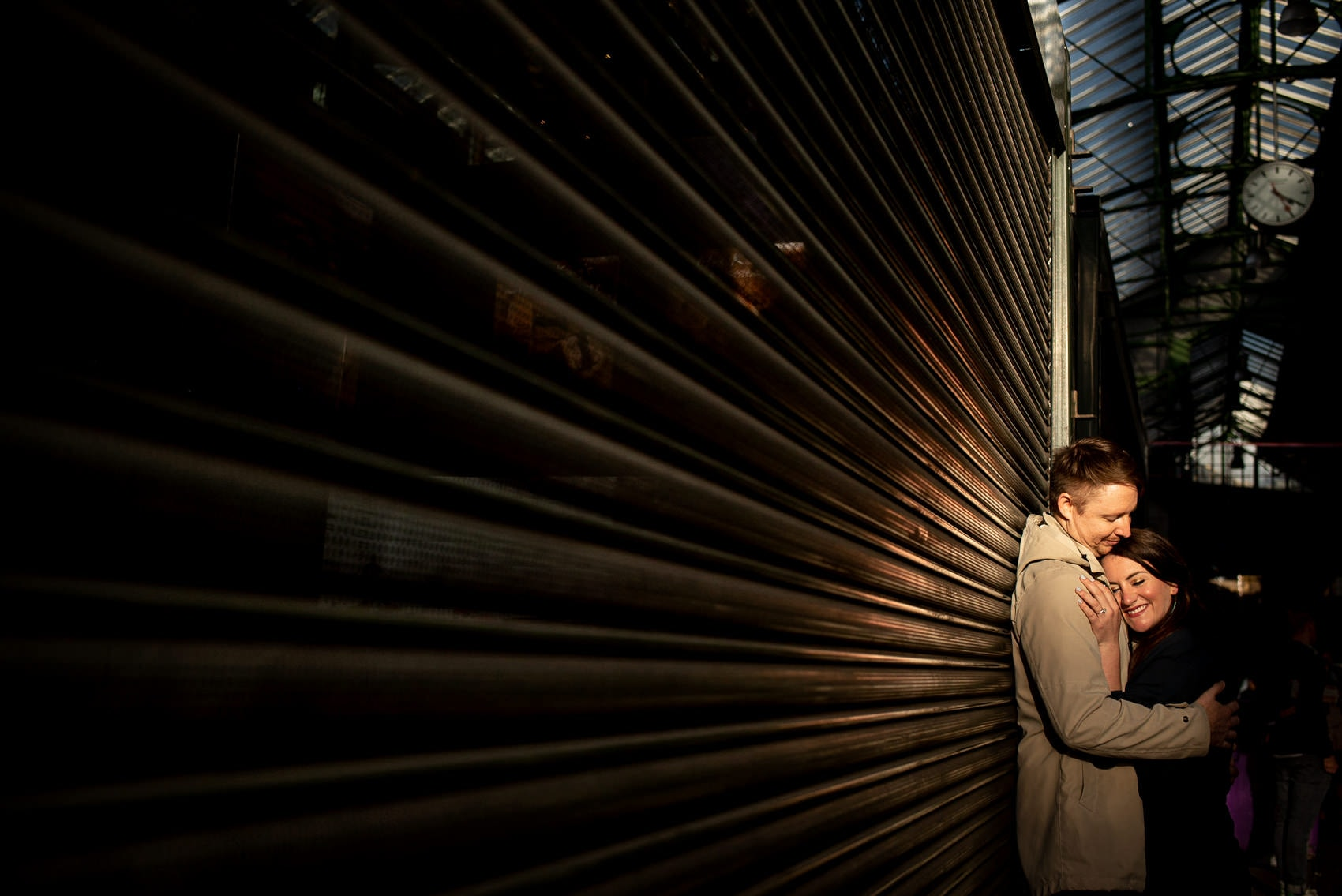 Photo of couple in Borough Market during their south bank engagement shoot