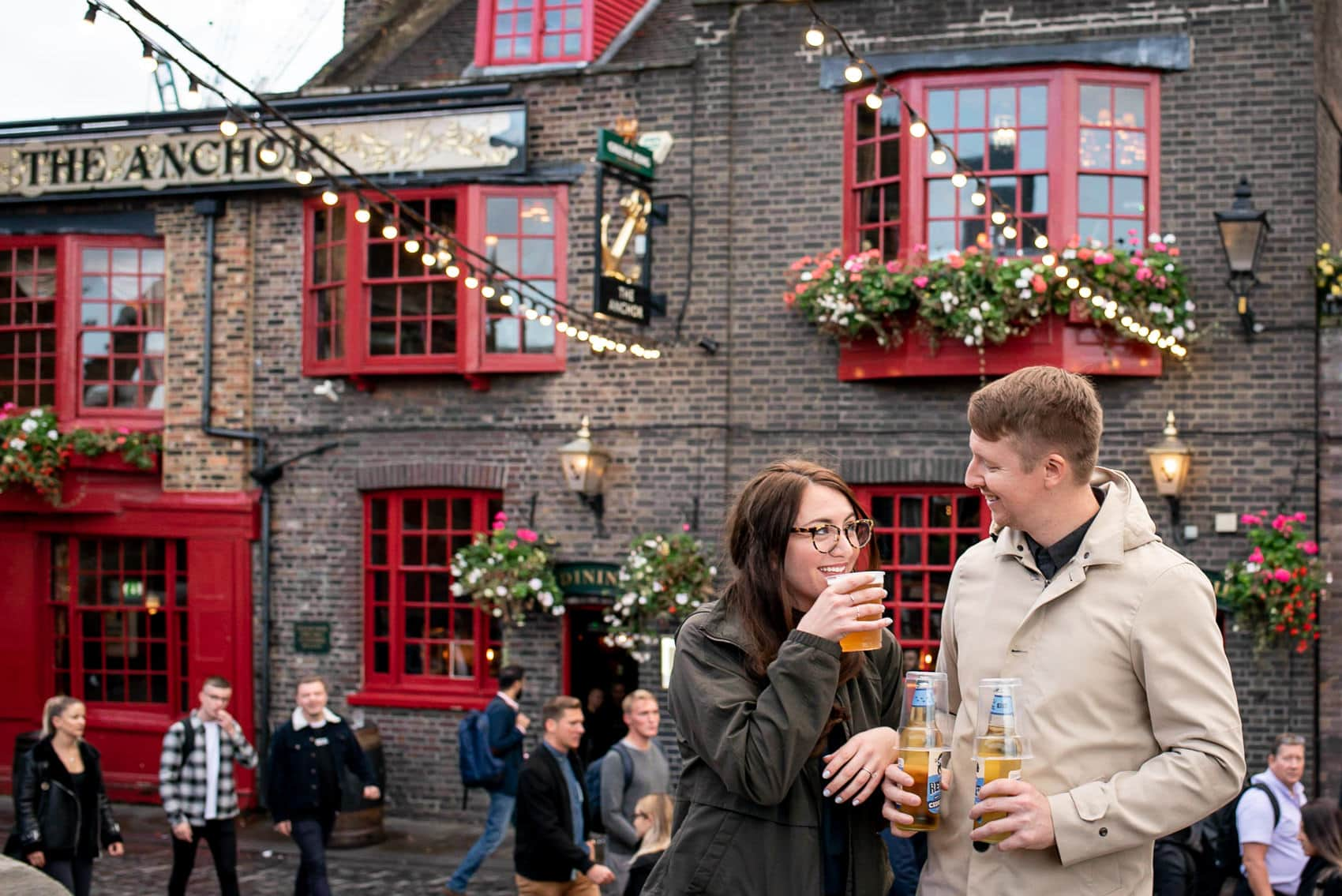 Photo of couple enjoying a pint outside the Anchor pub along London's south bank