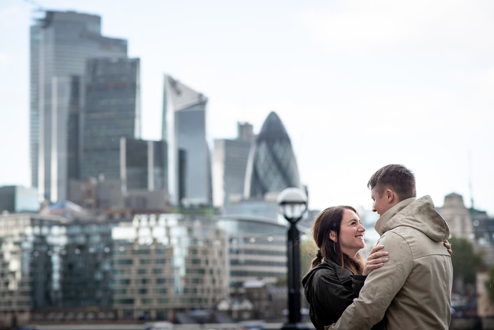Couple smiling in front of the city of London